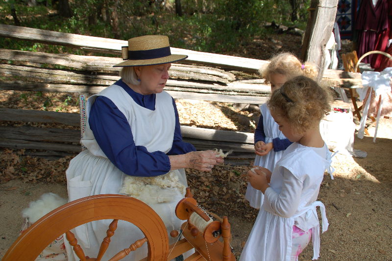Learning about wool spinning.