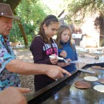 Young mill volunteers learn to flip pancakes!