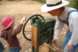 Historically, children would have earned flour for their family by operating the corn sheller at the local mill.